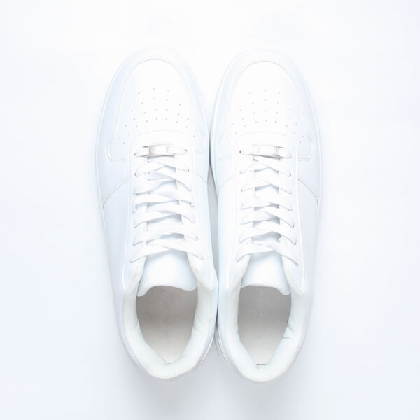 photo of white tennis shoes